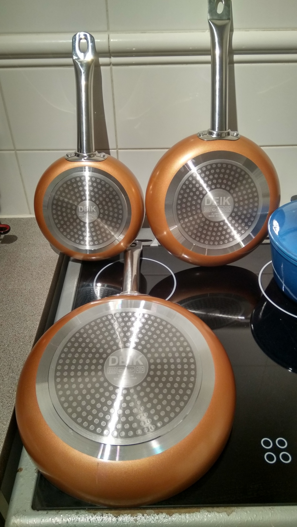 Set of 3 copper pans from the bottom