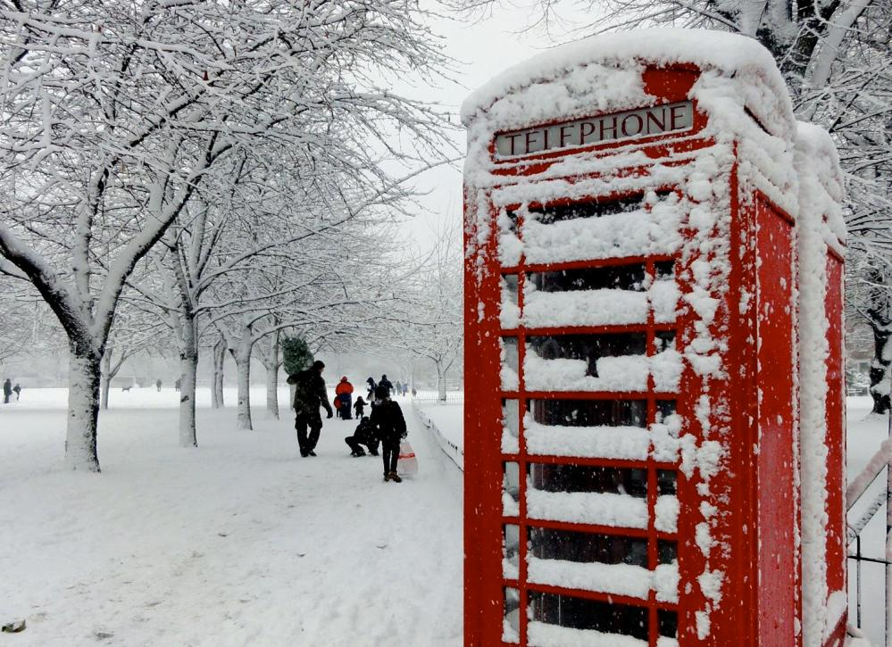 Phone box in London covered in snow